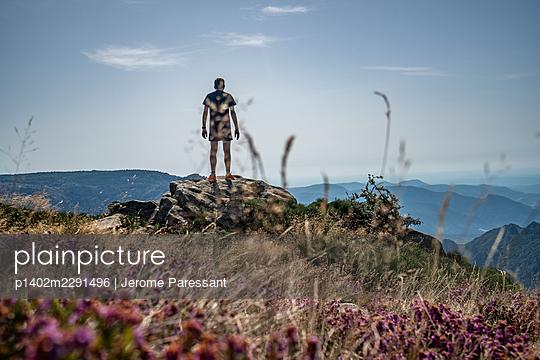 Man on a rock - p1402m2291496 by Jerome Paressant