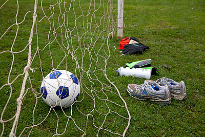 Football goal with football and trainers - p3882926 by Ulrike Leyens