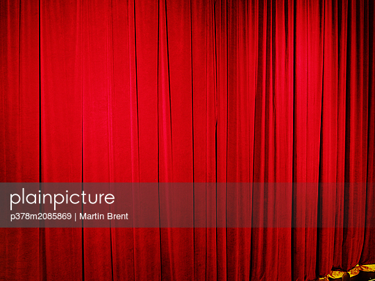 Red theatre drapes - p378m2085869 by Martin Brent