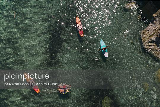 Sunbathing on the surfboard - p1437m2283300 by Achim Bunz