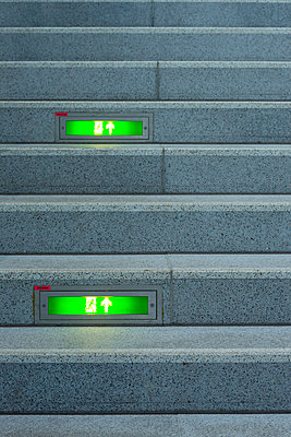 Public stairway with green emergency exit signs - p300m2219501 by Walter G. Allgöwer