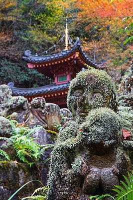Japan, Kyoto, Arashiyama, Otagi Nenbutsu-ji Temple, Rakan (disciples of Shaka, the founder of Buddhism) Buddhist images that were carved by worshipers. - p651m2006219 by Jane Sweeney