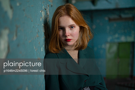 Red-haired girl in the staircase - p1646m2245096 by Slava Chistyakov