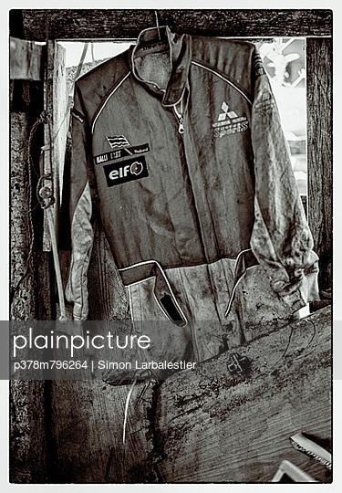 Old motorbike jumpsuit - p378m796264 by Simon Larbalestier