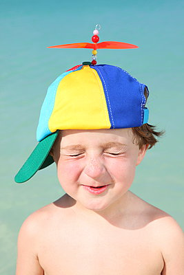 Child with funny hat - p045m892845 by Jasmin Sander