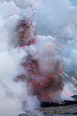 Close-up of volcanic eruption on shore - p1166m1414571 by Cavan Images