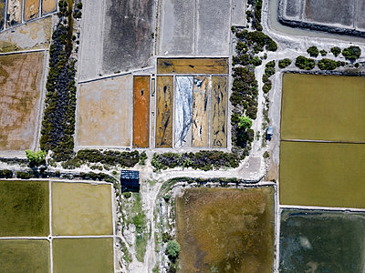Aerial view of Salt plantations - p1166m2094435 by Cavan Images