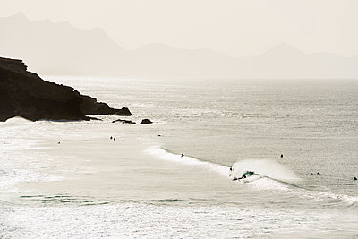 surfer, Playa del Viejo Rey, La Pared, Fuerteventura, Canary Islands, Spain - p1316m1422549 by Daniel Schoenen