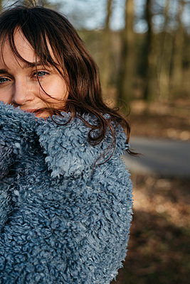 Young woman with a flurry coat - p1621m2258559 by Anke Doerschlen