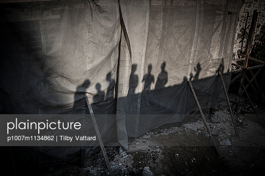 Shadows of people on a construction scaffolding  - p1007m1134862 by Tilby Vattard