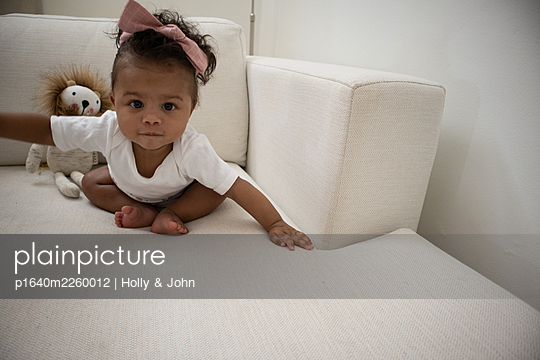 Multi ethnic toddler girl on the sofa - p1640m2260012 by Holly & John