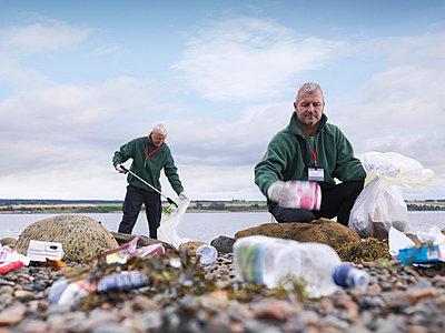 Environmentalist cleaning up beach - p42917313f by Monty Rakusen