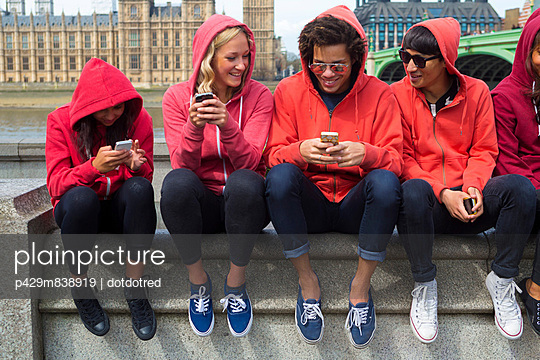 Group of young people looking at mobile phone
