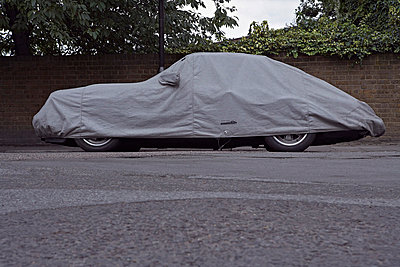 Covered car on road - p3881509 by Bill Davies