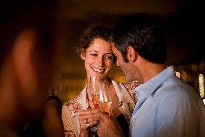 Couple having wine on terrace at night - p42913974f by Zero Creatives
