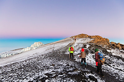 Climbers near the summit and receding glacier of Mount Kilimanjaro, Kilimanjaro National Park, UNESCO World Heritage Site, Tanzania, East Africa, Africa - p871m1584077 by Christian Kober