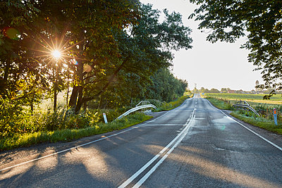 Empty road at sunset - p312m1470952 by Jan Tove