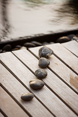 Stones on a Boardwalk, Maldives - p871m1073700f by Neil Emmerson
