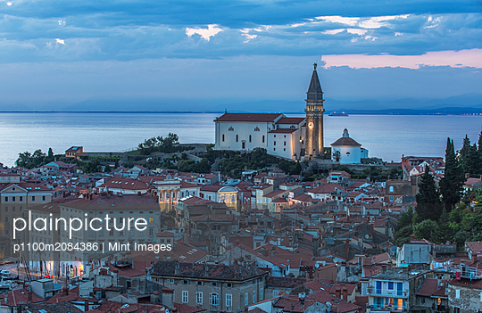 Aerial view of village buildings near lake,Piran, Coastal-Karst, Slovenia - p1100m2084386 by Mint Images