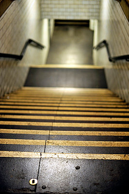 Steps leading down to subway - p1047m789481 by Sally Mundy