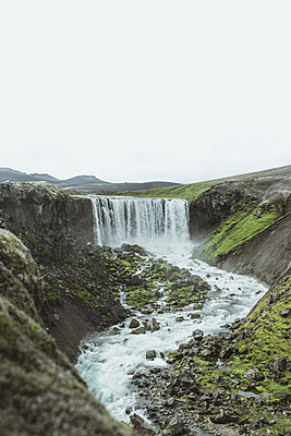 Hidden waterfall in the Highlands of Iceland - p1634m2210343 by Dani Guindo