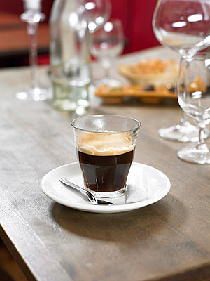 Still life of espresso coffee on table - p92410266f by Image Source
