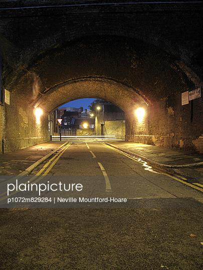 Road under railway arch. - p1072m829284 by Neville Mountford-Hoare