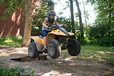 Boy on Four Wheeler - p1169m1463416 by Tytia Habing