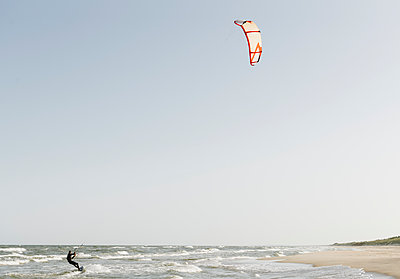 Kiteboarder riding the waves - p300m2118925 by Hernandez and Sorokina