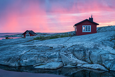 Wooden house on rocky coast - p312m1498898 by Peter Lyden