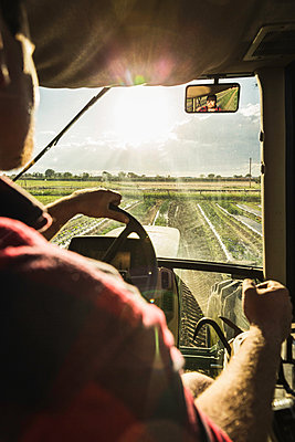 Over shoulder view through tractor windscreen on furrowed field - p429m1126186f by SuHP