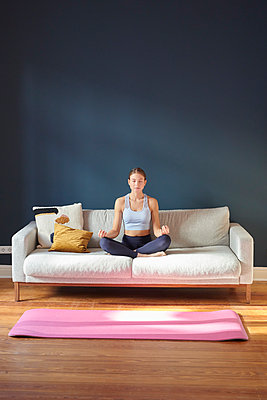 Young woman practicing yoga - p1124m1589393 by Willing-Holtz