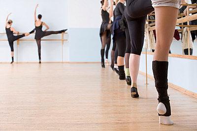 Low section of ballerinas in a dance studio - p30110637f by Vladimir Godnik