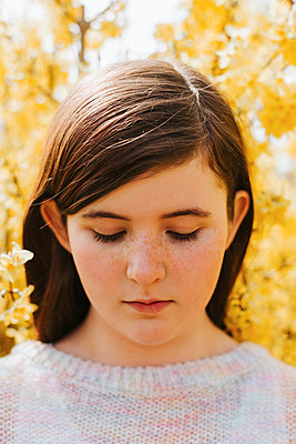 Girl in yellow flowers - p1507m2165739 by Emma Grann