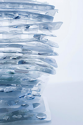 Stack of empty pill packets - p924m711217f by REB Images