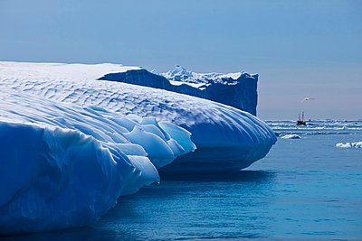 Fishing boat and iceberg, Arctic Ocean, Greenland - p1026m992027f by Romulic-Stojcic