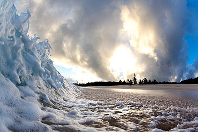 Wave crashing on beach at dawn, north shore of Oahu, Hawaii Islands, USA - p343m1543701 by Sean Davey