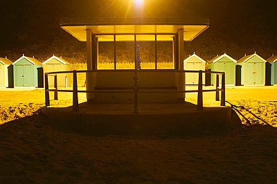 Empty kiosk on beach at night - p42918790 by Peter Muller