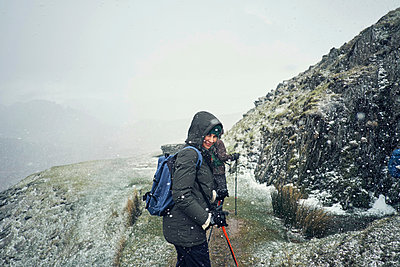 Hikers on mountain, Coniston, Cumbria, United Kingdom - p429m1494593 by Matt Lincoln