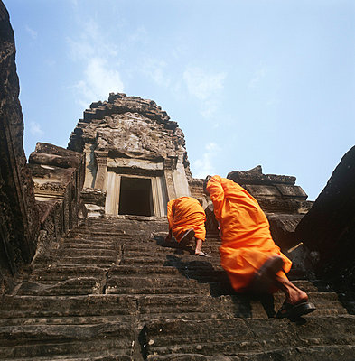 Buddhist monks climbing steps of Angkor Wat - p6440658 by Martin Stolworthy
