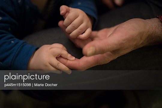 Baby and Adult's hands - p445m1515098 by Marie Docher