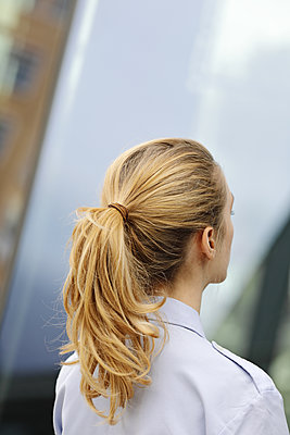 posterior headshot of blonde's girl ponytail - p1540m2110361 by Marie Tercafs