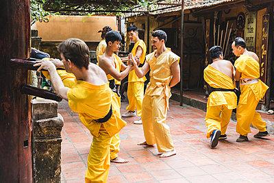 Vietnam, Hanoi, men exercising kung fu, european man learning kung fu - p300m2013199 by William Perugini