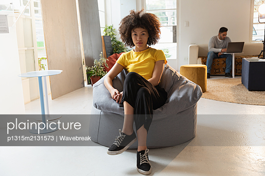 Young business creatives working in an office - p1315m2131573 by Wavebreak