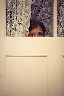 Hiding behind a door - p2940813 by Paolo