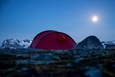 Tent on mountain at night - p426m844650f by Katja Kircher