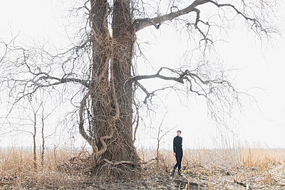 Woman and Tangled Tree - p1262m1082801 by Maryanne Gobble