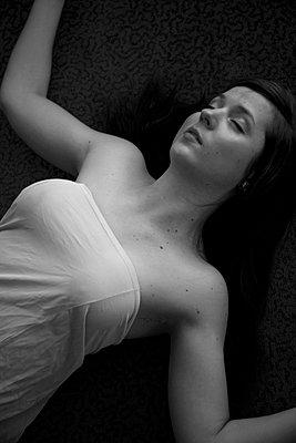 Woman on the floor - p4130557 by Tuomas Marttila