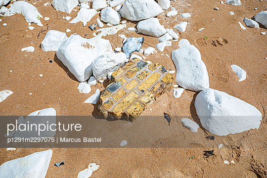 Broken piece of wall washed up on the beach - p1291m2297075 by Marcus Bastel