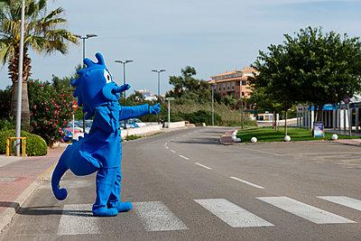 Blue comic figure on cross-walk - p1041m1042392 by Franckaparis
